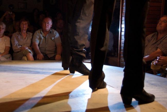Close up on male flamenco dancers' feet